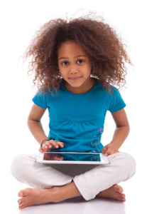 Image of little girl with an iPad - National Campaign Inspires a Movement to Keep Kids Safe