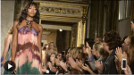 Image of model Naomi Campbell wearing a tie down maxi dress and walking down the run in Milan Fashion Week 2014