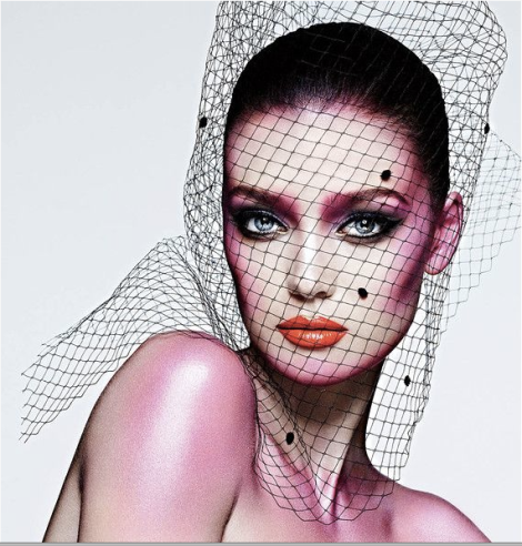 Image of a women in makeup and a black net over her head