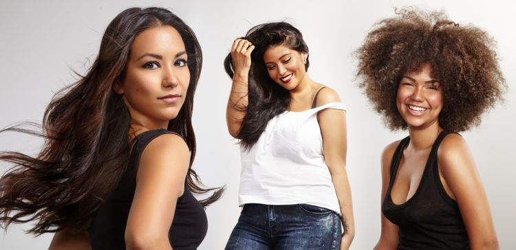 Image of 3 women with different hair types smiling