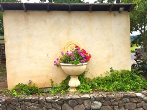 Beautiful flower arrangement in a flower pot attached to a wall