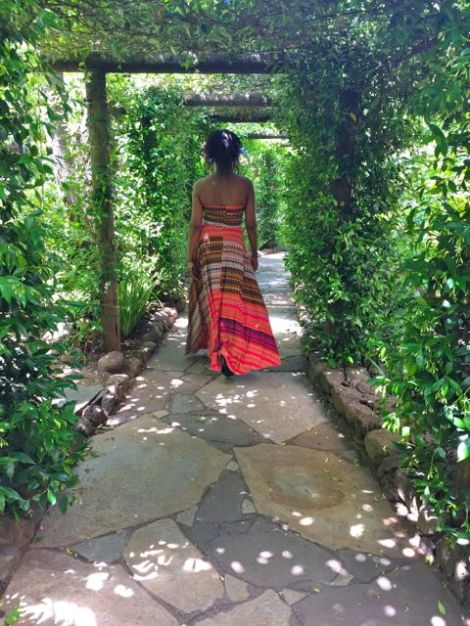 Image of woman walking through beautiful walkway to the Kenwood Spa