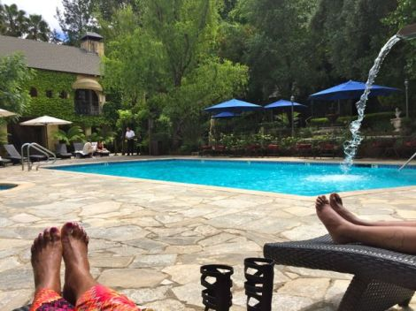 Image of two women lounging poolside at Kenwood Spa