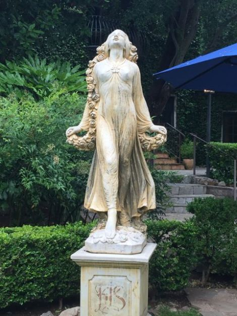 Image of female sculpture in the spa area (poolside) of the Kenwood Spa