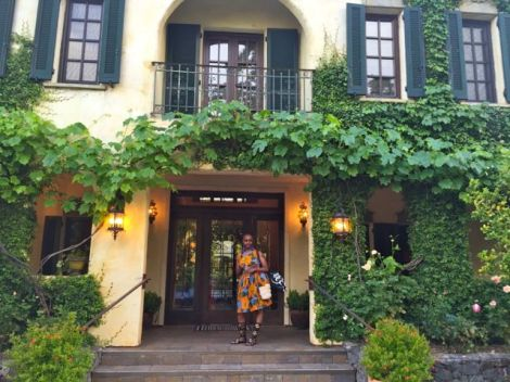 Image of woman standing in front of the breathtaking Kenwood Inn entrance