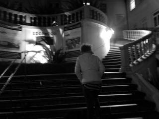 Image of young woman walking up the stairs.