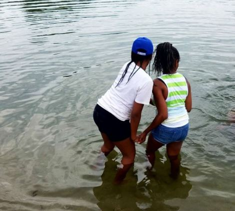 Image of two women wading in the water