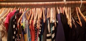 Image of rack of clothes in a closet
