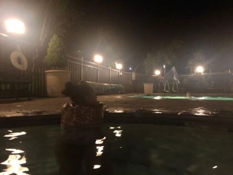 Juniper Springs Resort - Woman in the Jacuzzi during night time