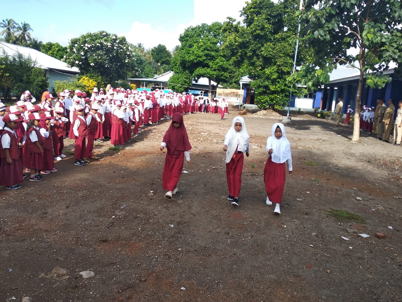 Image of school girls in uniform at a school parade